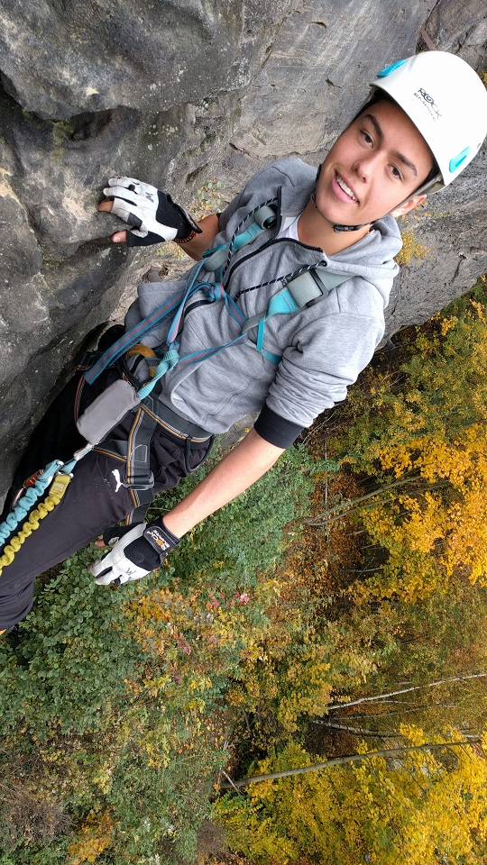 Climbing on via ferrata in autumn